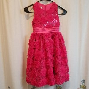 Pink rosettes and sequined tulle dress